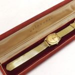 Gold watch in box